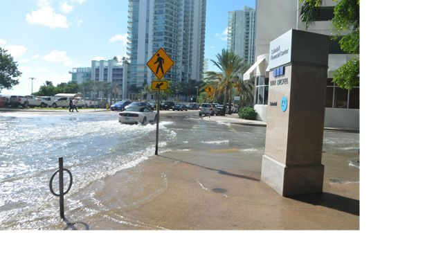 Sunny day flooding in the streets of the Brickell neighborhood in Miami.