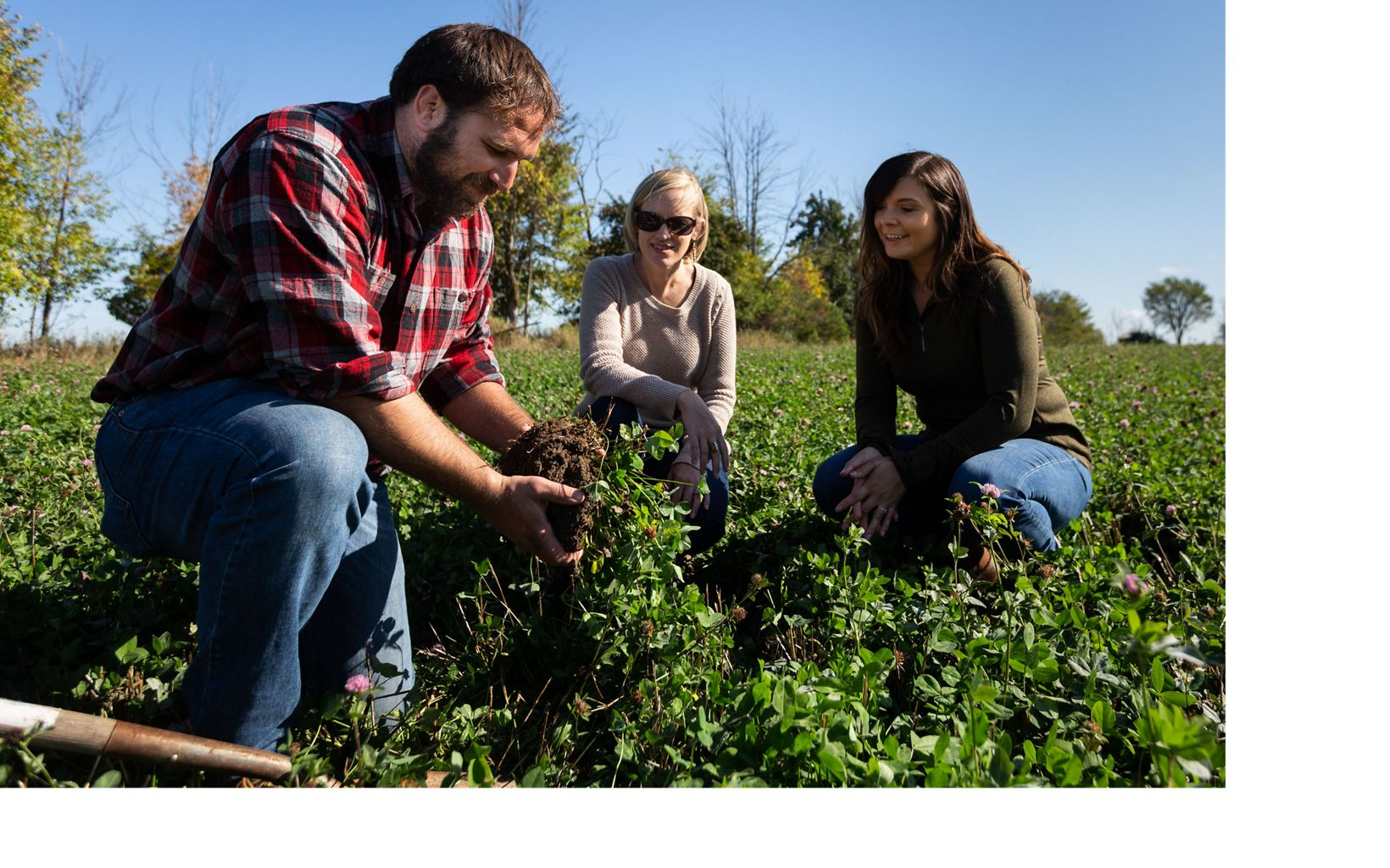 Michigan farmer, Mike Milligan, shows cover crops to Kellogg's Mary Gallagher (right) and The Nature Conservancy's Mary Fales.