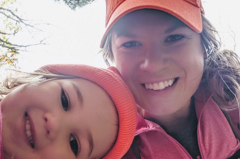 Molly Payne Wynne takes a selfie with her young daughter while exploring a forest.