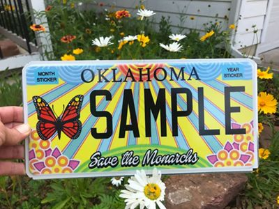 Specialty themed monarch license plate with wildflowers.
