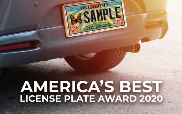 """Monarch themed license plate on a car with text that reads """"America's Best License Plate Award 2020."""""""