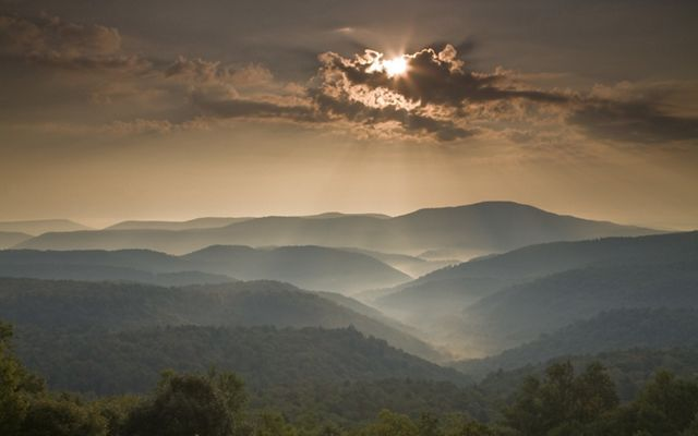 Photo of mountains in the sunset.
