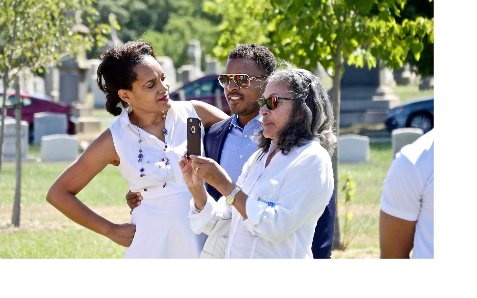 Event organizer Gayle George (l) with extended family members during a celebration of ancestors John and Arabella Weems, freedmen buried at Mt. Olivet Cemetery.
