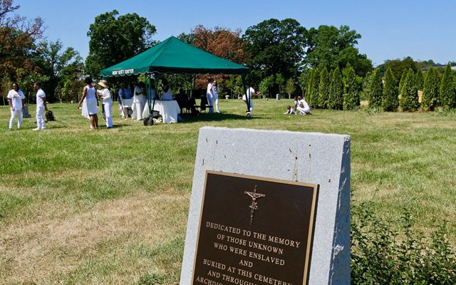 Descendants of freedmen John and Arabella Weems gather at Mt. Olivet Cemetery to honor the legacy of their ancestors, August 9, 2019.