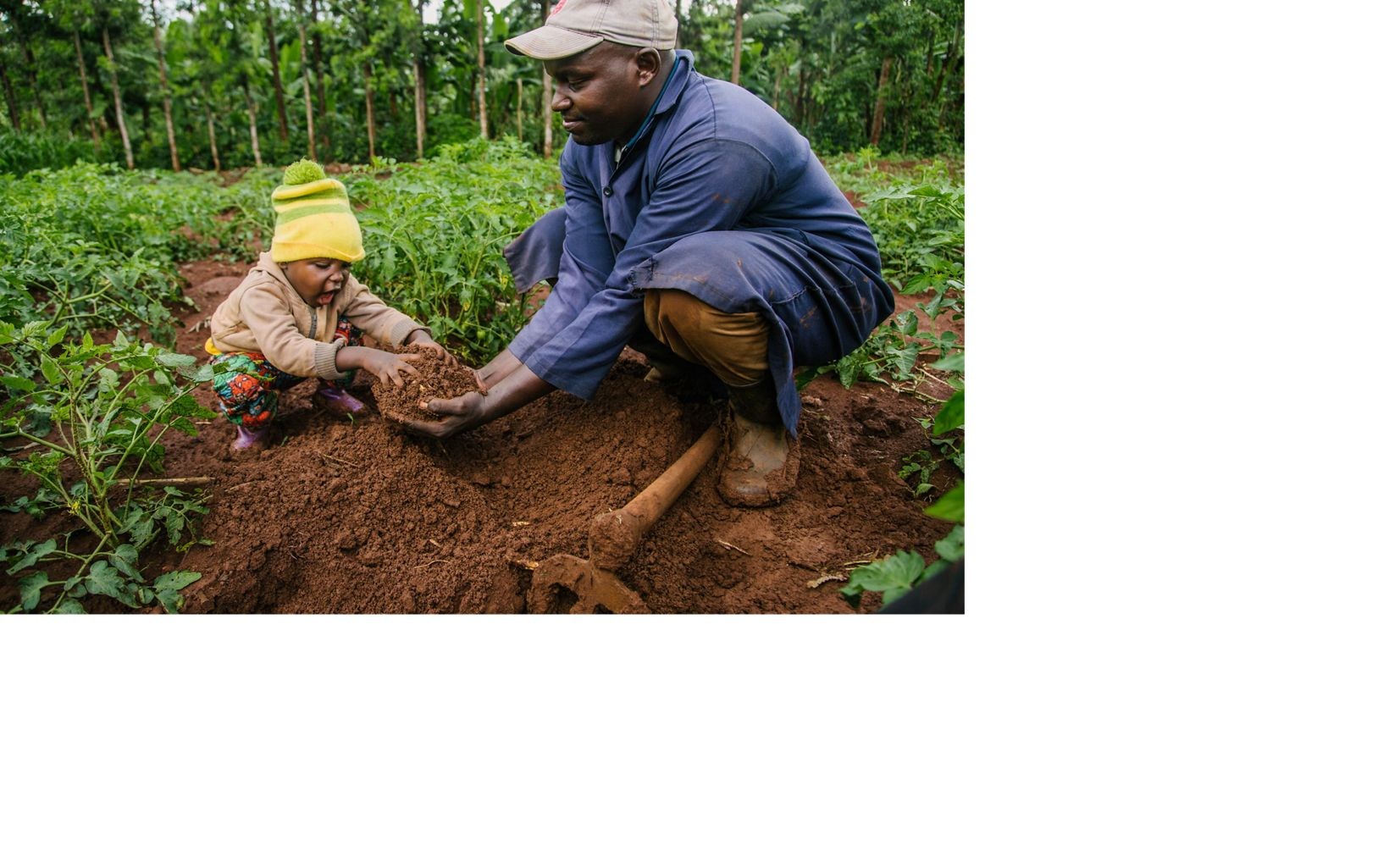 man and child playing with dirt