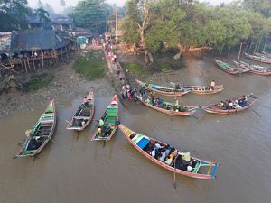 in Dalah, Myanmar, board boats for the morning commute to Yangon.