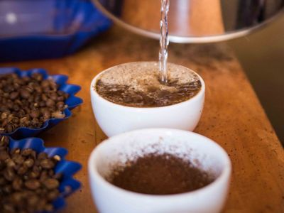 Rose grinds and tastes each coffee sample to ensure high quality.