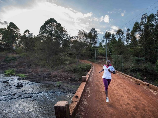 Jane Mbogo runs an average of 28 kilometers a day, meeting farmers and talking to them about the Upper Tana-Nairobi Water Fund.