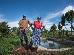 Anna and Joseph Gatheru stand on their farm