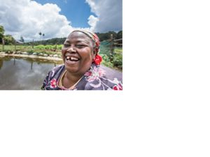 Elena Kinyua, an innovative farmer in the foothills of Mt. Kenya (in the background). Grows carrots, tree tomatoes, cabbage, avacado and has livestock. She has got a water pan from NWF. She's put a bag of manure in the water, so that it creates algae that feeds fish, and enriches the water she puts on her plants.