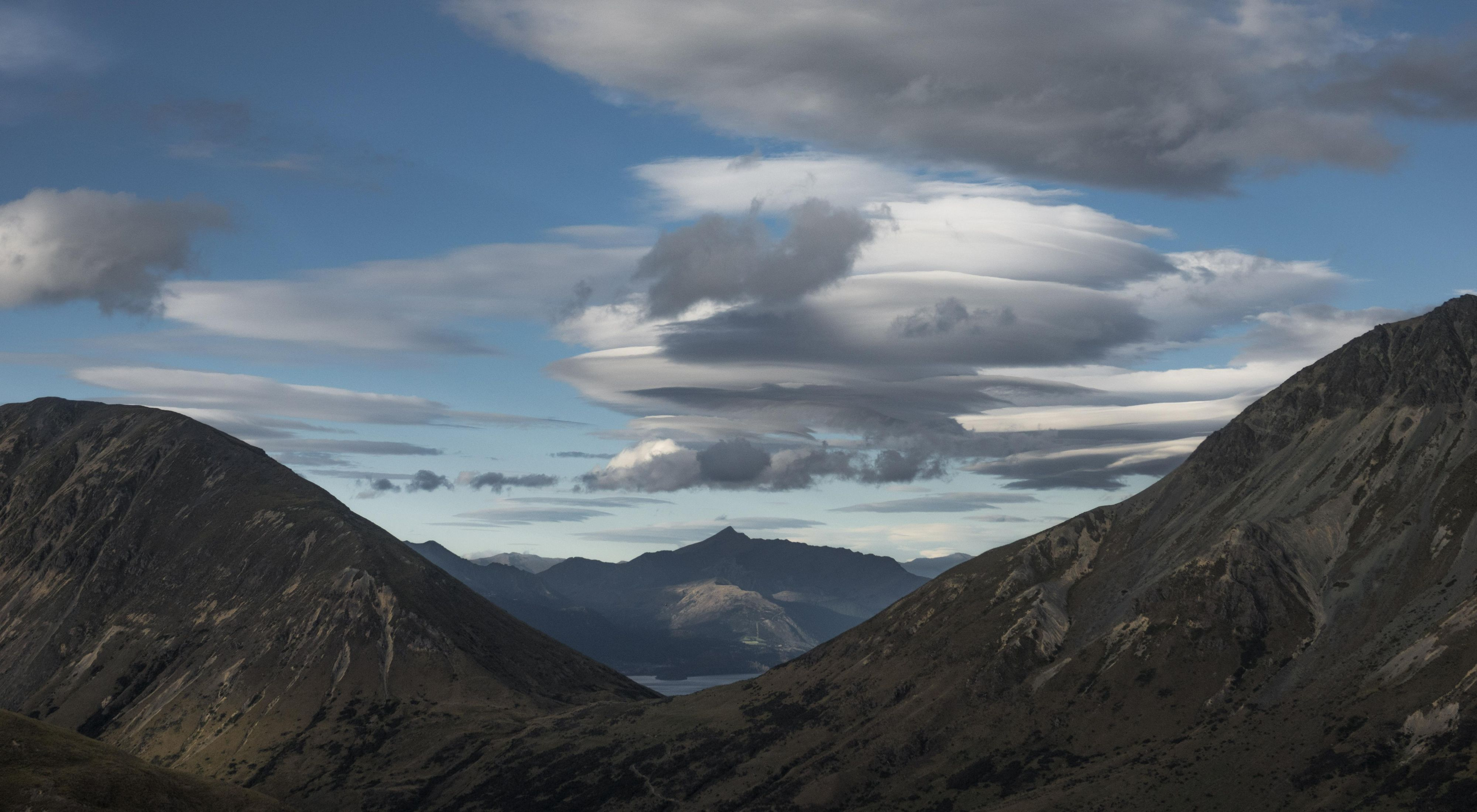 An aerial view of mountains and clouds in New Zealand's South Island.