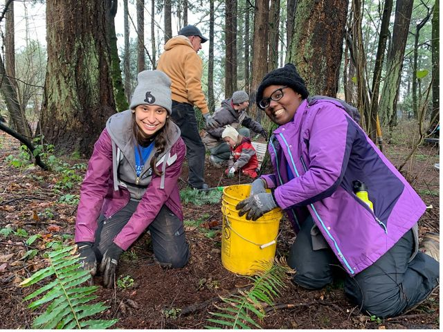 TNC Oregon's 2018-2019 AmeriCorp member Nanda Ramos plants trees at a Friends of Trees event.