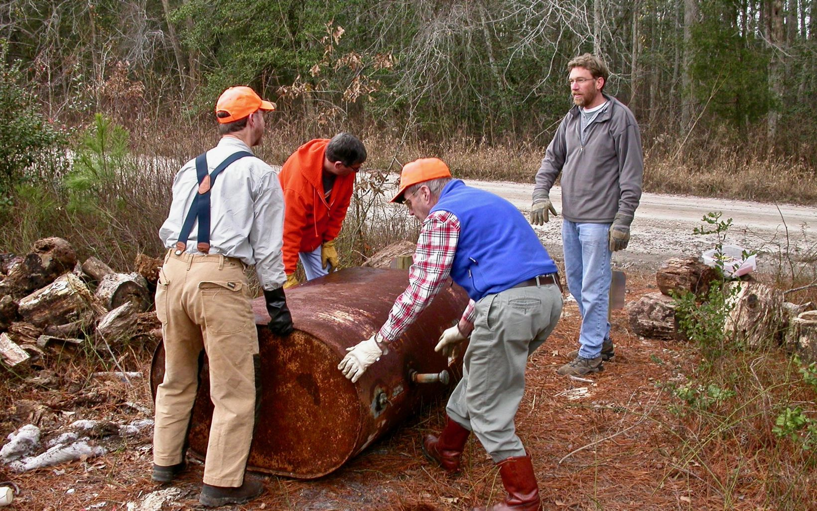 Nassawango Stewardship Committee members remove a rusted oil tank during a workday at the preserve.