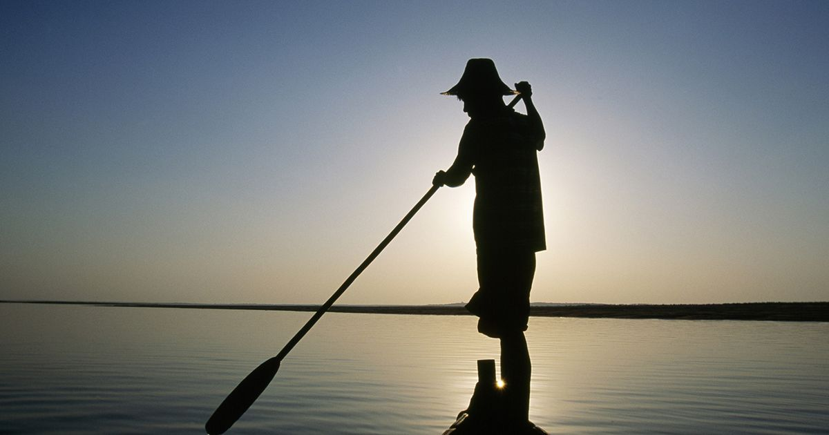A fisherman paddles on the Irrawaddy River in Kyaukmyaung, Myanmar.