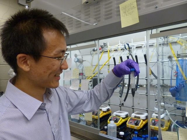 Haoran Yang in front of one of his nanotech waste heat transfer experiments.