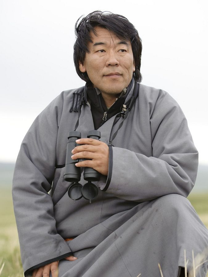 close up portrait of man outside holding binoculars