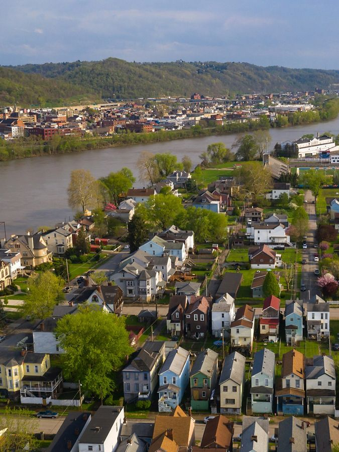 aerial view of west virginia town along a river
