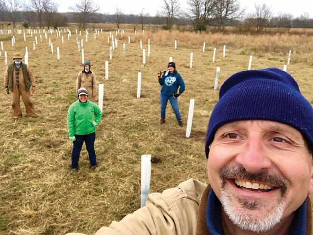 Group photo of State Director Mike Fuhr and volunteers planting trees.