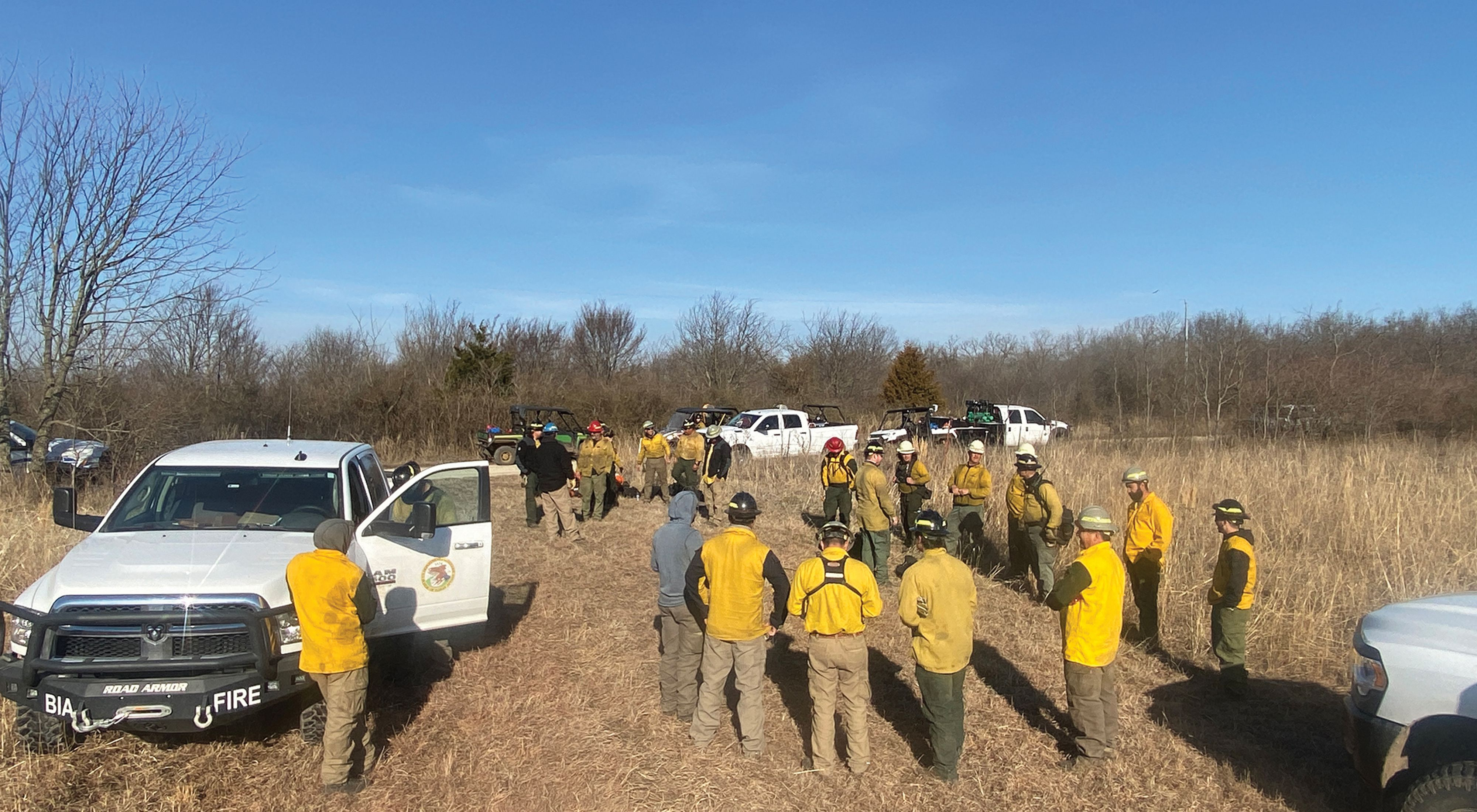Group of fire practitioners preparing to conduct a controlled burn.