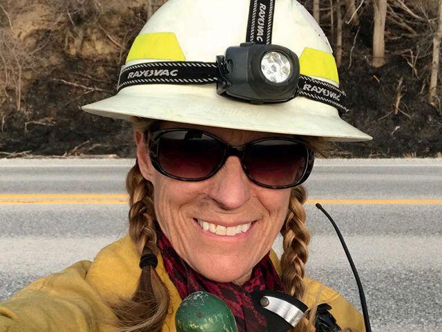 Women wearing controlled burn gear.