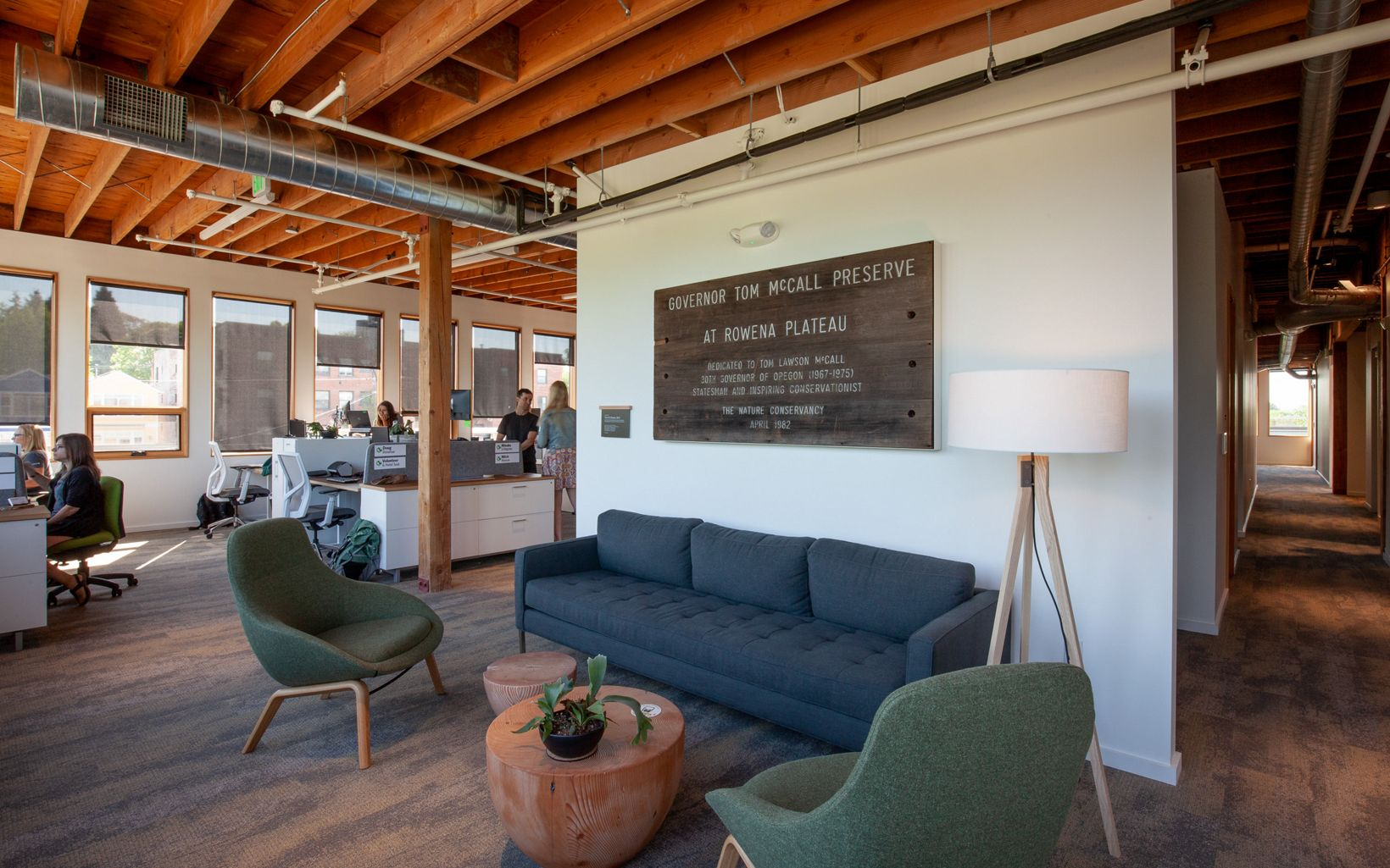 Staff and guests find multiple areas to work and meet. This lounge area, adjacent to the open workspace, features retired signage from TNC's Tom McCall Preserve near Rowena.