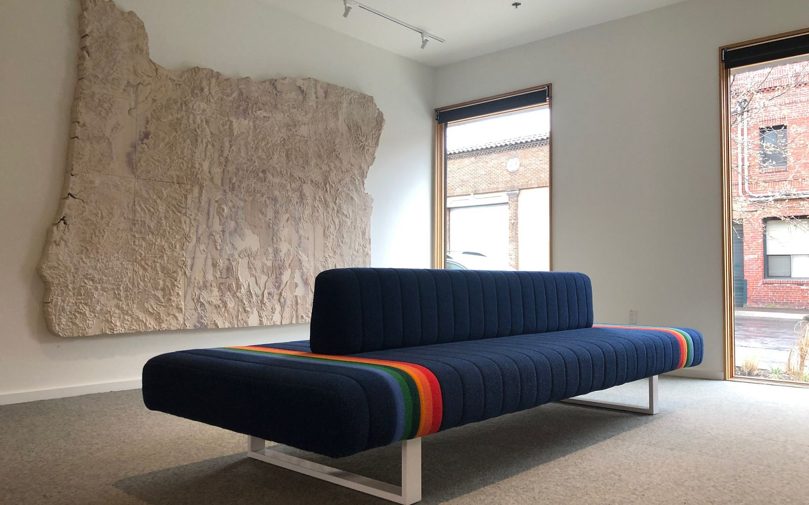 "The lobby features a custom-designed couch using the ""Crater Lake"" pattern from Pendleton Woolen Mills and a map carved with precise topographic data from TNC science staff."
