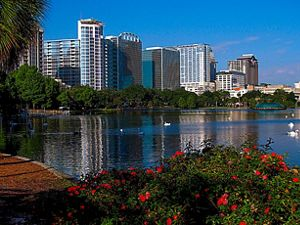 Lake Eola Park in downtown Orlando Florida with the skyline in the background.