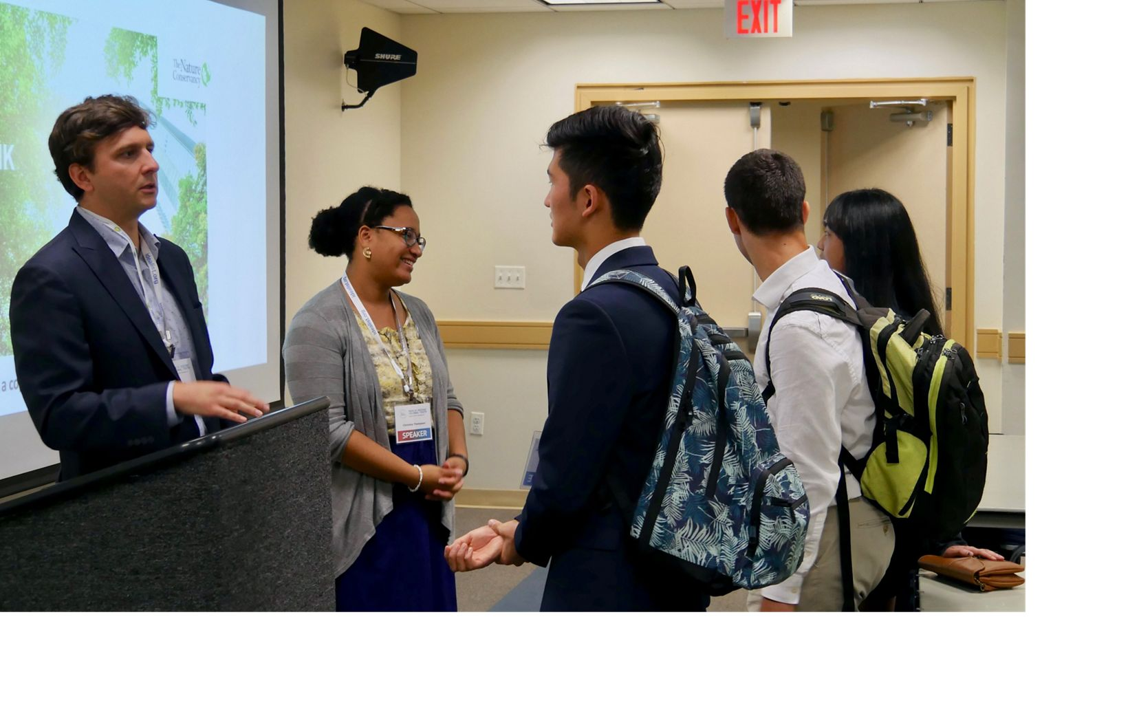 Josh Kurtz (l) and Christina Thompson (r) talk with students during a youth advocacy workshop held by TNC at the UN Youth Assembly at George Washington University, August 2019