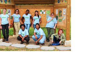A group of young volunteers pose in a TNC kiosk.