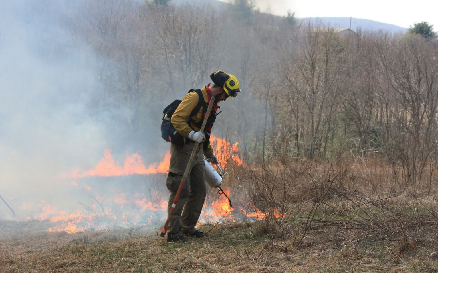 A member of the Pennsylvania fire team conducts a prescribed burn.