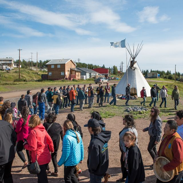 The Łutsël K'é Dene First Nation community participates in a round dance to mark the official protection of Thaidene Nëné.