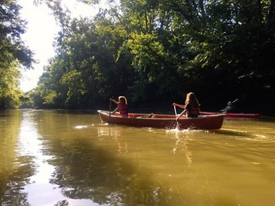 Two women paddling a canoe in a river