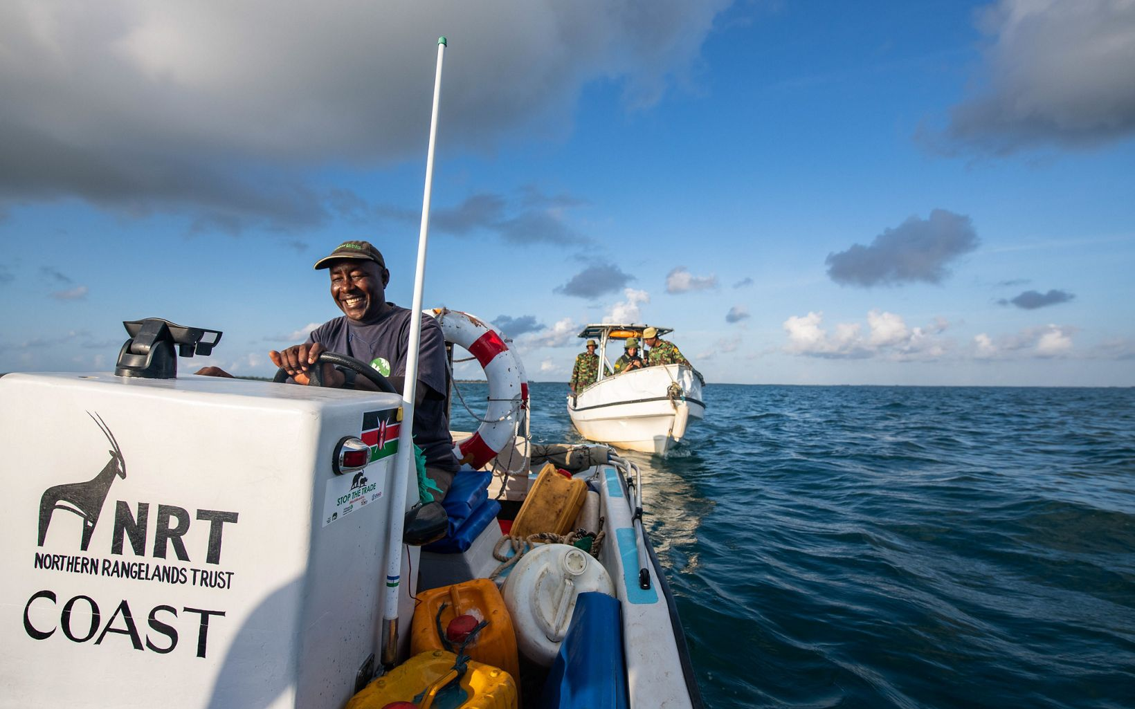 NRT boat driver Aboud Mohamed Omar (left) leads a group of NRT-trained Pate Marine Community Conservancy (PMCC) rangers on a patrol of the octopus closure area in Kenya.