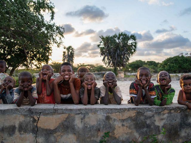 kids smile and laugh at camera