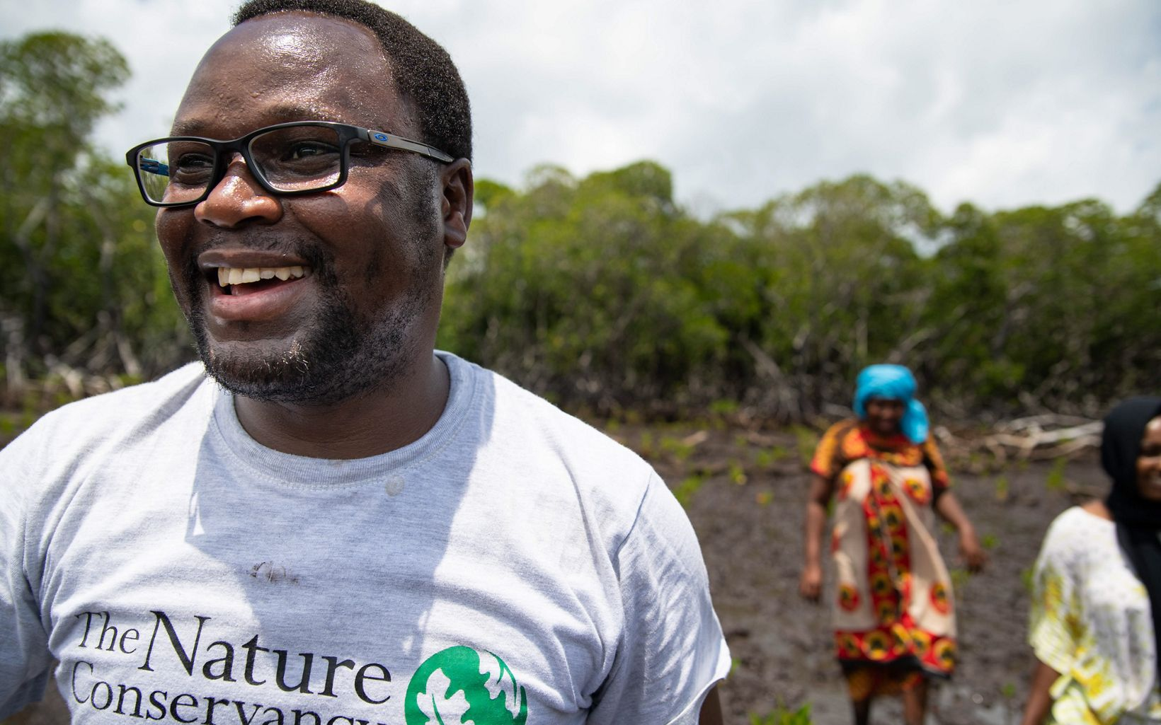 """TNC Africa Fisheries Strategy Manager George Maina leads a mangrove restoration project in Lamu, Kenya. """"Mangroves are the tropical rainforests of the ocean,"""" George says."""