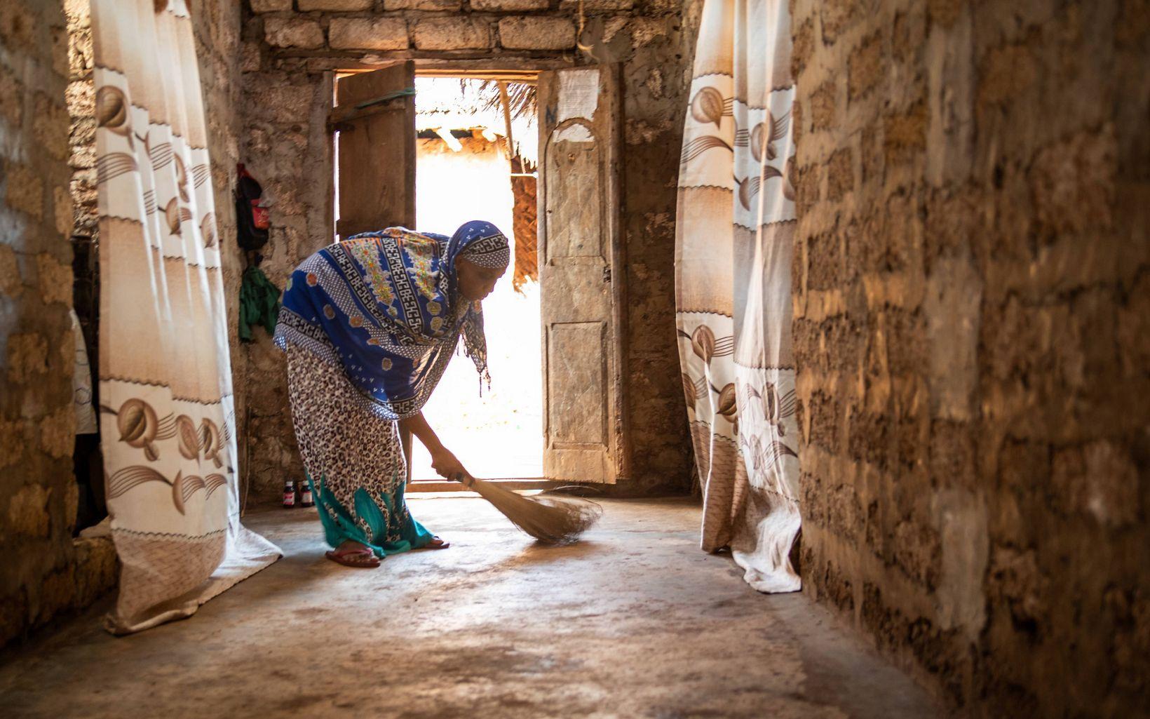 woman sweeping a floor