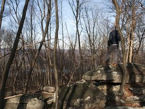 A Nature Conservancy staff member explores part of the Kittatinny Ridge located near the Cove Mountain Preserve.