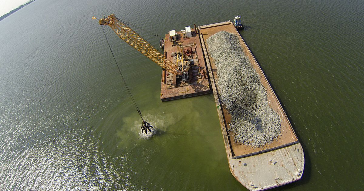 Granite rock is methodically placed in Virginia's Piankatank River to form the newest, 25-acre oyster reef in the Chesapeake Bay watershed.