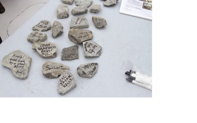 Piankatank River Oyster Recovery Project partners signed pieces of granite as part of a 2017 dedication ceremony for a newly constructed 25-acre oyster reef.