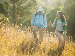 Hikers in a grassland.