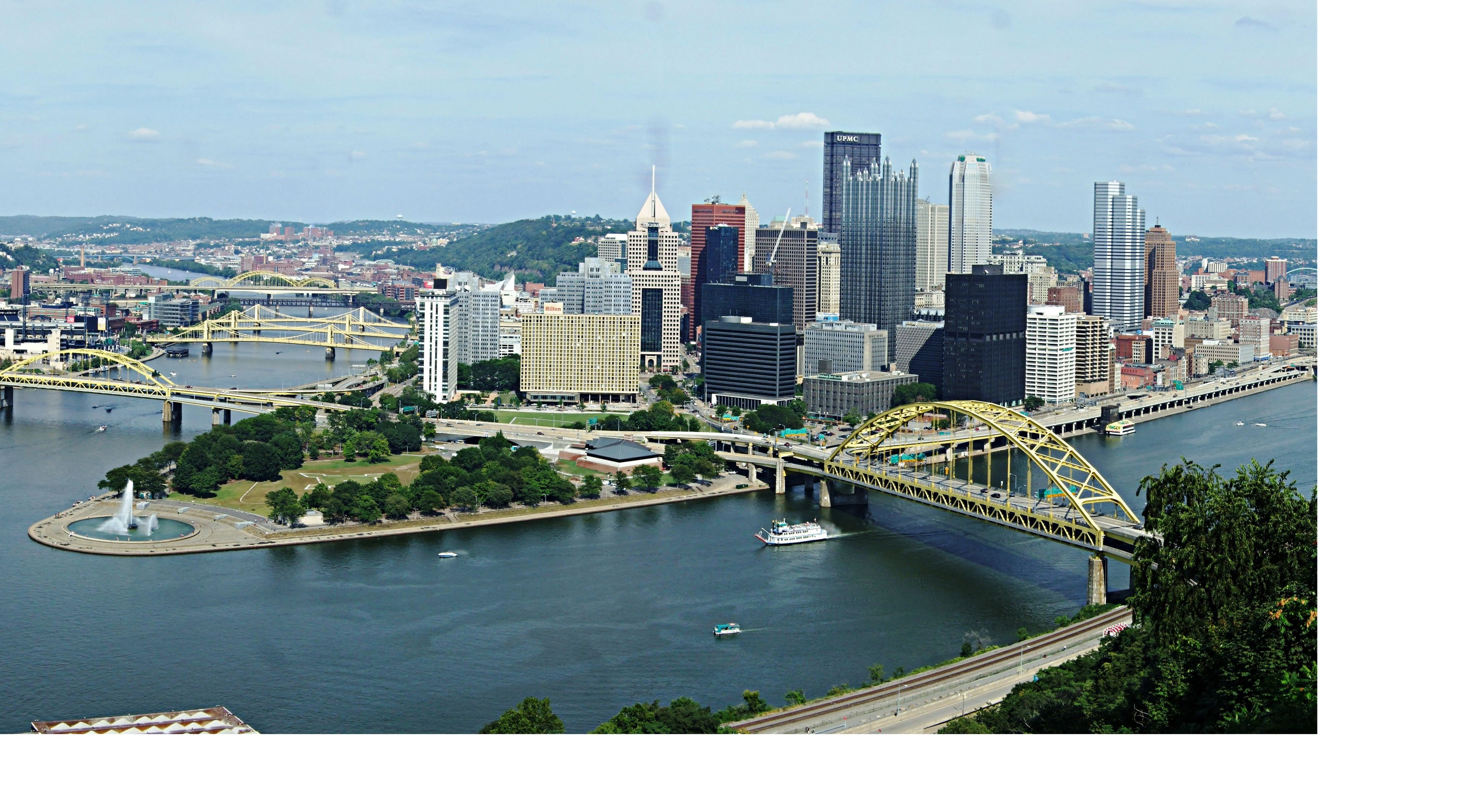 A city surrounded by two rivers and yellow bridges.
