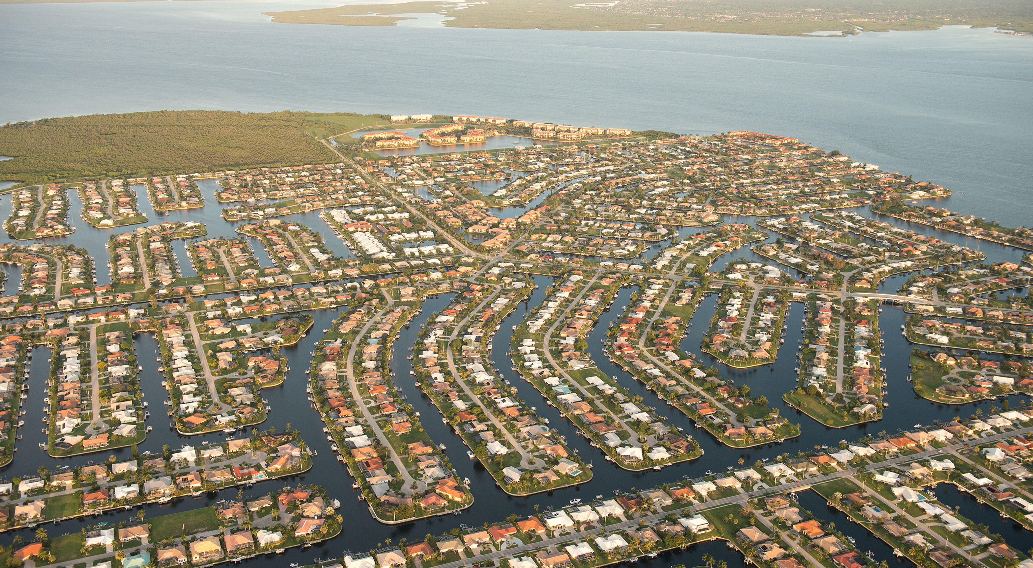 Aerial view of Punta Gorda, Florida showing densely packed neighborhoods surrounded by water.