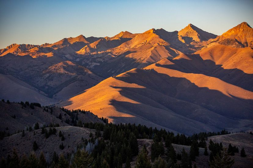 Shadows at sunset highlight the landscape of the Pioneer Mountains. Parts of this region are included in the Resilient and Connected Landscapes work.