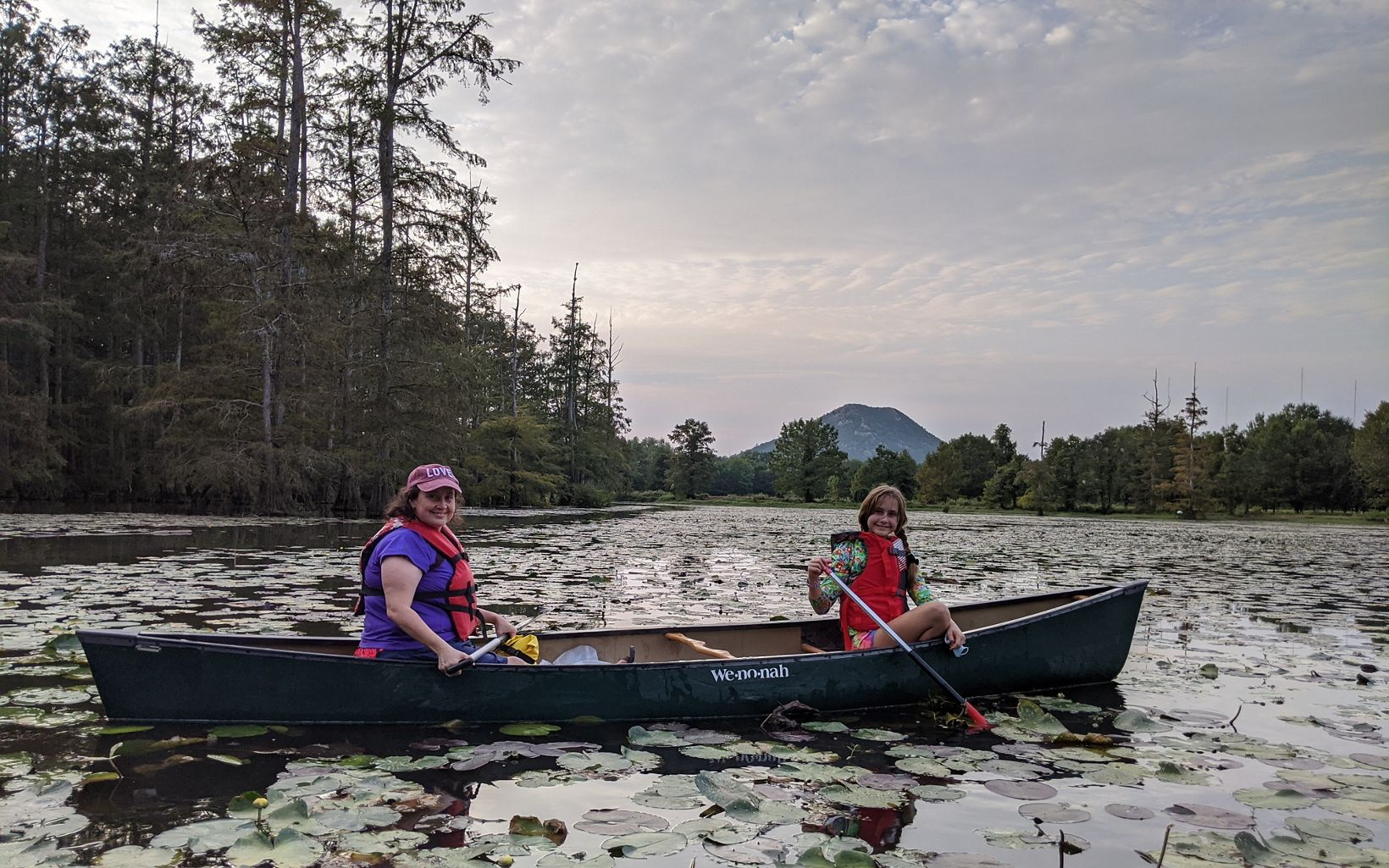 A woman and a little girl in a canoe.