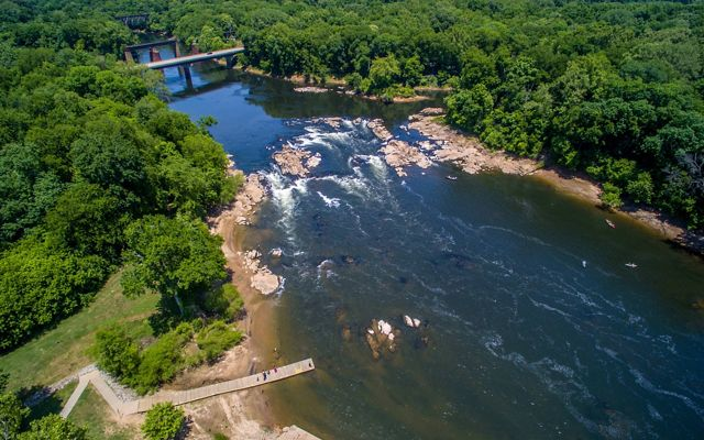 A photo of the Roanoke River and rapids, surrounded by forests.