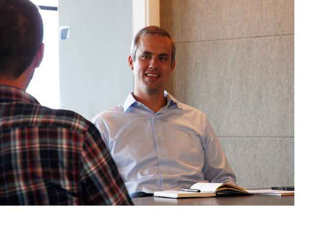 Rob Wood, TNC in Maine Director of Governmental Relations & Climate Policy, meets with a colleague.