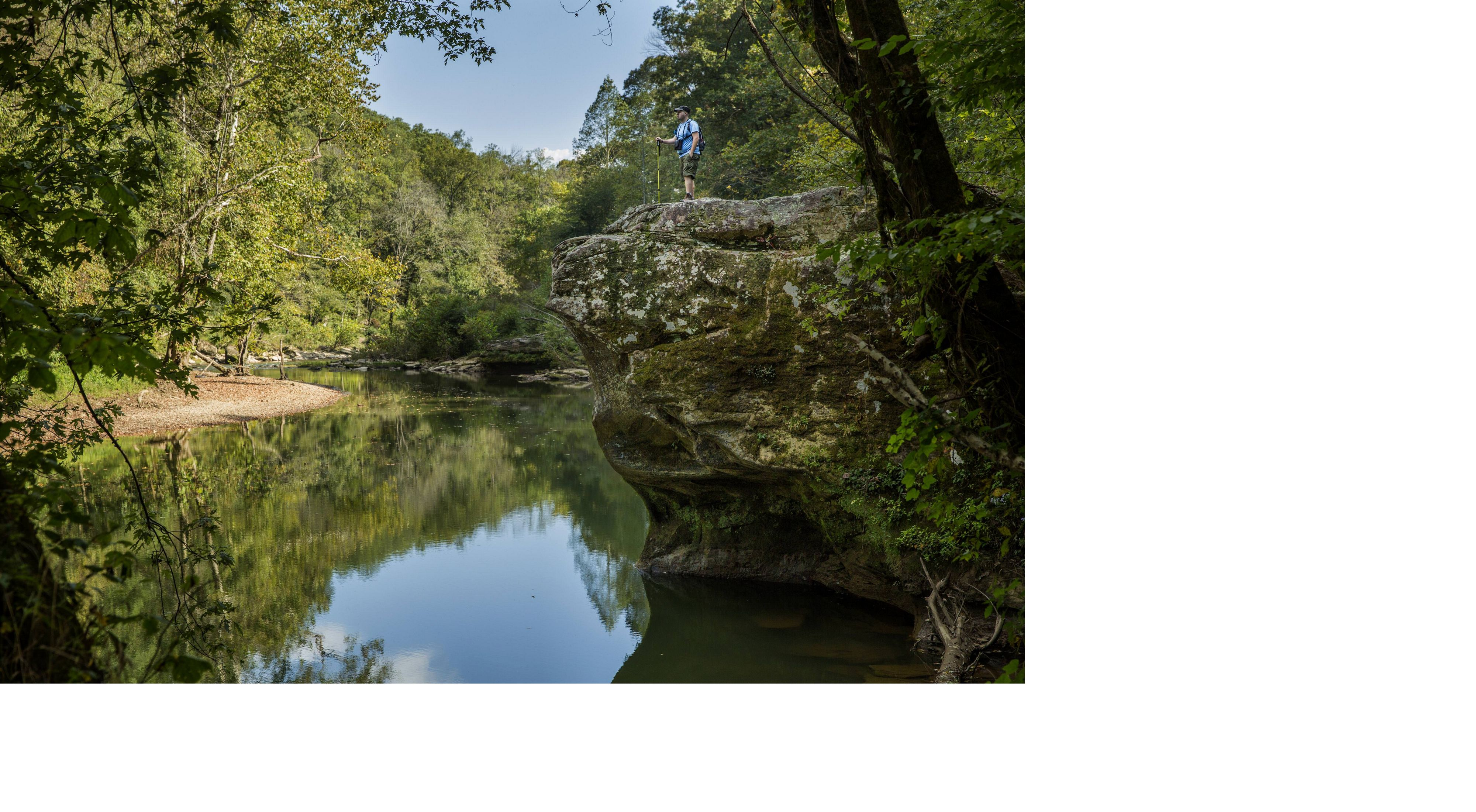 A hiker looks out over the Rockcastle River.