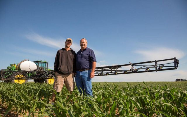 Roric Paulman and son in agricultural field in Nebraska.