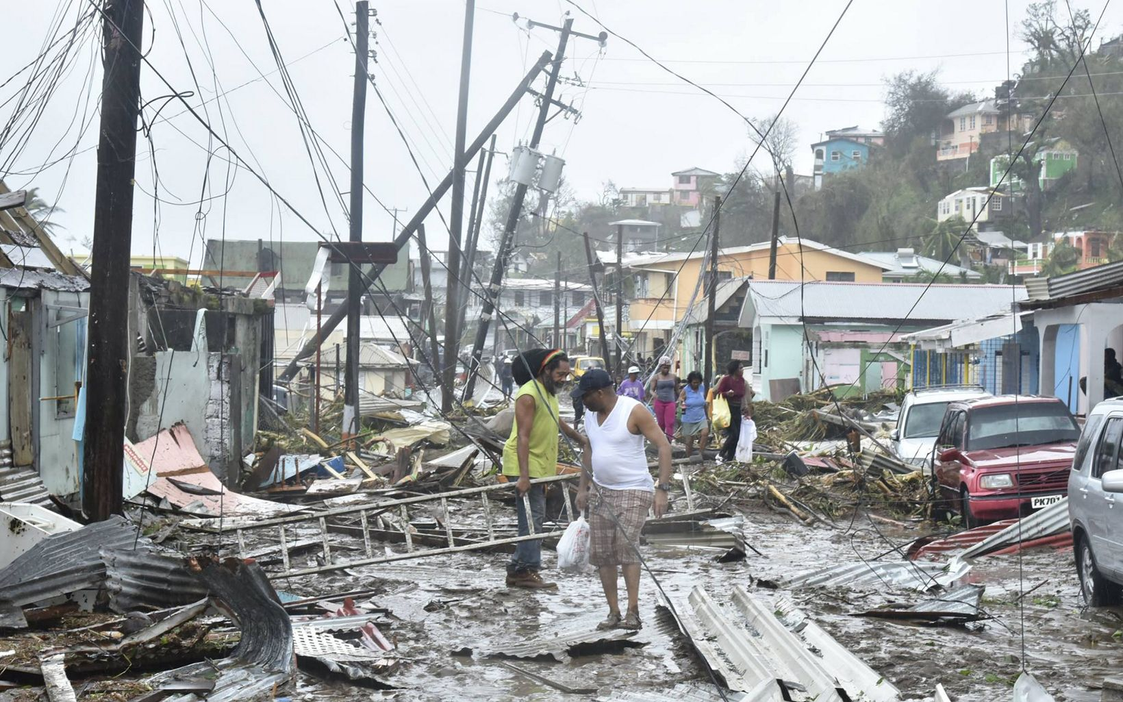 Residents of Dominica clear debris after Hurricane Maria
