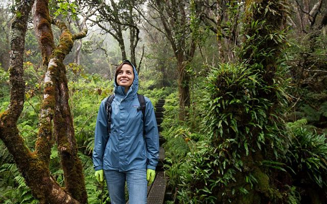 girl in a rain jacket in the jungle
